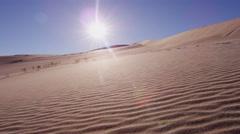 POV walking travel desert footprint sun adventure trek Stock Footage