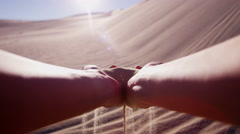 Sand desert hands sun flare grains hot famine charity - stock footage