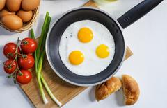 Scrambled Eggs on a Pan - stock photo