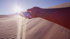 Sand desert hand sun flare grains hot famine charity - stock footage