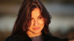 Close Up of a Young Brunette Woman Enjoying the Sun Rays During Sunrise Arkistovideo