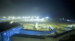 Time lapse illuminated Hong Kong International Airport night time China Asia - stock footage