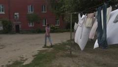 Drying clothes. neighborhood of a small town. girl walking.Krichev Stock Footage
