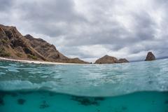 Arid Island and Clouds Stock Photos