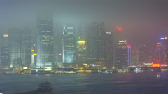 Time lapse Hong Kong  Promenade illuminated 2 IFC Victoria Harbour Stock Footage