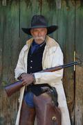 Stock Photo of Portrait of Cowboy with Rifle, Shell, Wyoming, USA
