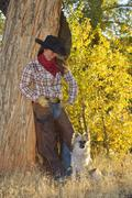 Stock Photo of Portrait of Cowgirl with Dog, Shell, Wyoming, USA