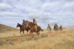 Cowboys and Cowgirls Riding Horses, Shell, Wyoming, USA - stock photo