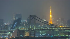 Time lapse Tokyo Metropolis illuminated Rainbow Bridge   Minato Japan - stock footage