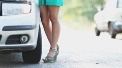Slender legs in miniskirt girl near the car Stock Footage