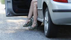 Slender legs in miniskirt girl out of the car Stock Footage