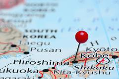 Hiroshima pinned on a map of Asia - stock photo