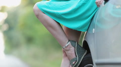 Slender legs in miniskirt girl near the car Stock Footage