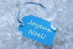 Label On Ice With Joyeux Noel Mean Merry Christmas Stock Photos