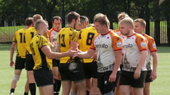 Rugby players shake hands with opponents after the match. - stock footage