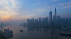Time lapse sunrise Huangpu River Shanghai Tower The Bund China - stock footage