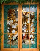 Christmas ball and decoration behind window.. Stock Photos