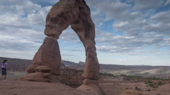 Time lapse of tourists at Delicate Arch, Arches National Park Stock Footage