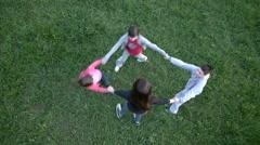 Kids running on the green field Stock Footage