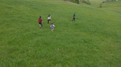 kids running on the green field - stock footage