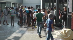 Syrian Migrants at the Eastern Railway Station in Budapest Hungary 33 washing Stock Footage