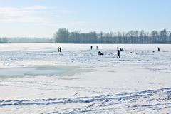 Ice-skating on frozen lake behind sunny of the day .. Stock Photos