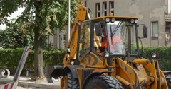 Driver in The Yellow Excavator Cabin Moving Turning Walking People Road Signs Stock Footage