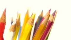 One side of colour pencils isolated on white, rotation, close up - stock footage