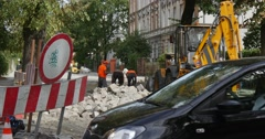 Workers in Workwear Are Moving The Blocks at The Street Road Repair Paving the Stock Footage