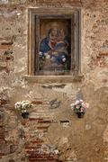 picture of madonna or saint on an old wall - stock photo