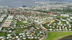 Aerial buildings roads Reykjavik Iceland capitol city homes suburbs Stock Footage