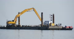 Working Excavator On The Board Of The Barge Another Cargo Barge Stands Near Stock Footage