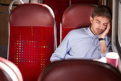 Stock Photo of Sleeping passenger using public transport