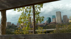 Slider shot of  capital city of Edmonton in Alberta, Canada with wooden fence. Stock Footage