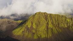 Aerial Icelandic region Iceland highlands volcanic area rocky peaks green - stock footage