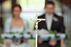 The groom and bride at the wedding ceremony in church - stock photo