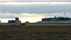 Running reindeer and man (eskimo, nenets) on the background of Oil rig Stock Footage