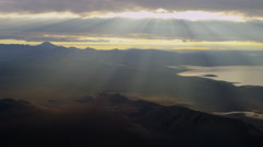 Aerial distant Katla volcano sunlight rays lake river delta Iceland - stock footage