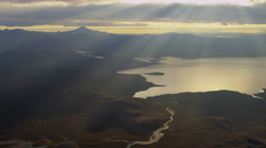 Aerial sunlight rays meltwater lake river deltas Katla active volcano Iceland - stock footage