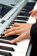 Artist hands of a piano player Stock Photos