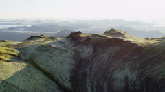 Aerial glacial meltwater mountain lake region Iceland volcanic Stock Footage