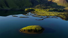 Aerial glacial meltwater lake volcanic region mountain landscape Iceland - stock footage