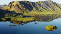 Aerial volcanic mountain landscape glacial meltwater lake Iceland - stock footage