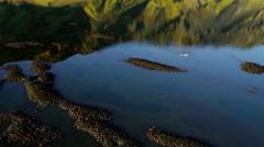 Aerial meltwater lake wildlife volcanic mountainous region Iceland - stock footage