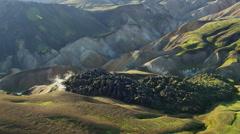 Aerial Iceland steam venting volcanic cooled lava Landmannalaugar - stock footage