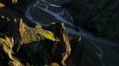 Stock Video Footage of Aerial volcanic peaks lava rock glacial meltwater river deltas Landmannalaugar