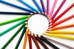Assortment of colored pencils with shadow on white background - colored crayo Stock Photos