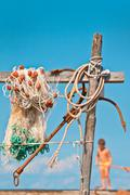 Fishnet with anchor in background with a little boy Stock Photos