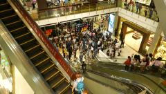 Fashion designer interview, shopping complex atrium escalators on foreground Stock Footage