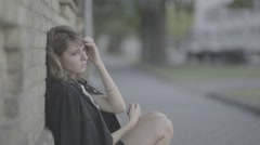 a desperate woman in depression in slow motion (ungraded slog2 flat) - stock footage